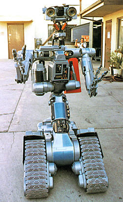 <i>By Jevon Phillips and Patrick Day, Los Angeles Times Staff Writers</i><br> <br> It turns out Johnny 5 is indeed alive.<br> <br> The announcement in 2008 that Harvey and Bob Weinstein's Dimension Films would be remaking the 1986 family comedy about a lovable wisecracking robot given a personality by a bolt of lightning is welcome news for vintage robots fans.<br> <br> Already this decade they've seen some of their favorite old-time robots given sparkly new sheens: KITT the car, the dreaded Cylons and Optimus Prime. But what sort of improvements have these recent robot revisions brought?