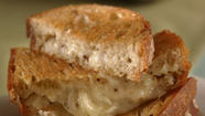Grilled gruyere and marinated onion sandwich