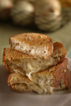 "GRILLED CHEESE, ALL GROWN UP: Gruyere with marinated onions.  <a href=""http://www.latimes.com/features/la-fo-grilledcheeserec2aug08,0,235991.story"">Click here for the recipe.</a>"