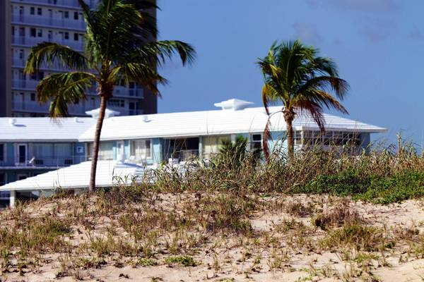 (abb) fl-destroy-dune-112311d - Condo owners at the Mayan Beach Club and Ocean Lane Villas say this sand dune blocks their ocean view and have applied for a state permit to destroy it. Photographed Wednesday, Nov. 23, 2011. Amy Beth Bennett, Sun Sentinel