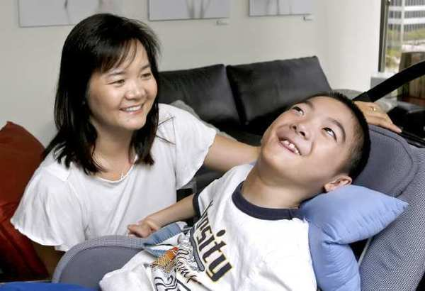 Nancy Leung, with her son Aidan in 2011. Aidan suffers from brain damage he received shortly after his birth at Verdugo Hills Hospital.