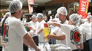 The numbers were impressive: 100 employees of Advance Auto Parts packing meals for 10,000 people. And all in less than two hours.