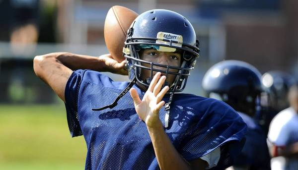 Notre Dame Green Pond quarterback Kordell Theadford looks for a receiver during practice on August 22, 2012.