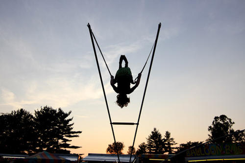 Autumn Gregory, 10, of Whitehall, bounces high at Coplay Community Days held at the corner of 2nd and Keefer Streets on Thursday.