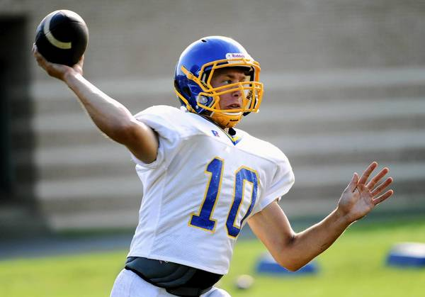 Wilson quarterback Ryan Dailey throws to a receiver on Wednesday during football practice at the high school.