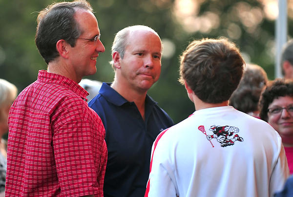 Former state Del. D. Bruce Poole, left, of Hagerstown and his son Graham Poole, 14, talk with congressional candidate John Delaney, center, at the Washington County Democratic Picnic in Williamsport Thursday.
