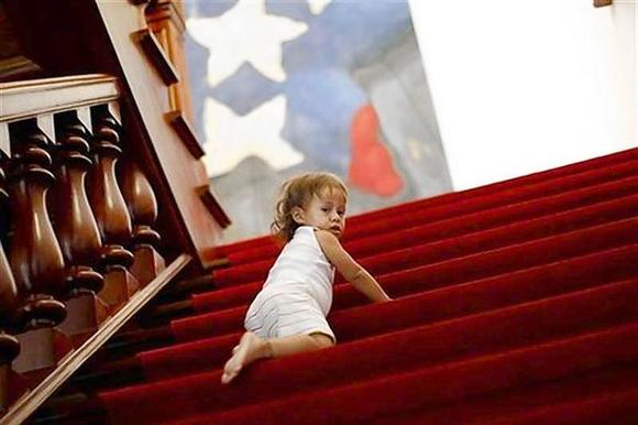 Baby climbs stairs