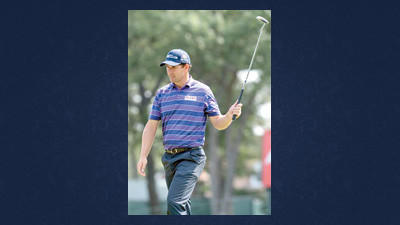 Padraig Harrington raises his putter after making a birdie on the 14th hole during the first round of The Barclays golf tournament at Bethpage State Park in Farmingdale, N.Y., Thursday.