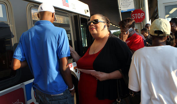 Chicago Teachers Union president Karen Lewis leaflets commuters at the 95th Street-Dan Ryan Red Line stop regarding ongoing teacher contract negotiations.