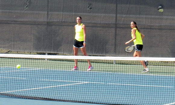 Wamego High School¿s No. 1 doubles team of Kaylee and Lanie Page compete in their opening round match.