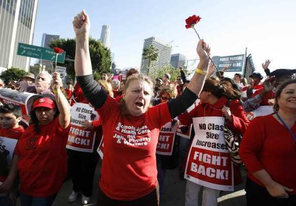 Teachers take part in a union-sponsored protest in downtown Los Angeles in 2008. Proposition 32 would ban direct contributions to California candidates by corporations and labor unions.