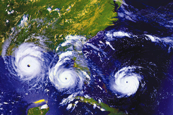 Satellite images show Hurricane Andrew as it appeared Aug. 23 (right), Aug. 24 (center) and Aug. 25 (left) in 1992.