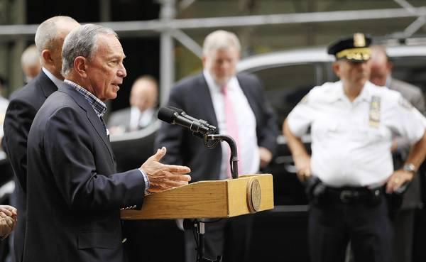 New York City Mayor Michael Bloomberg speaks to reporters at a press conference on Fifth Avenue outside the Empire State Building near the scene of a shooting in New York City. Police said 58-year-old Jeffrey Johnson shot and killed a former co-worker 41-year-old of Hazan Imports