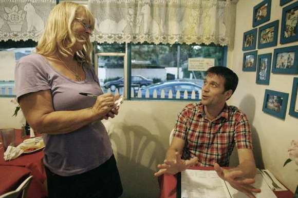 Waitress Paula Kidby, left, listens to Jim Whiting as he compliments the restaurant on their desserts at Riverside Cafe in Burbank on Wednesday, August 22, 2012.