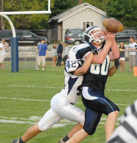 Petoskey tight end Pat Antonides (80) looks back to make a catch during the 2011 season opener against Sault Ste. Marie. The Northmen won, 42-0.