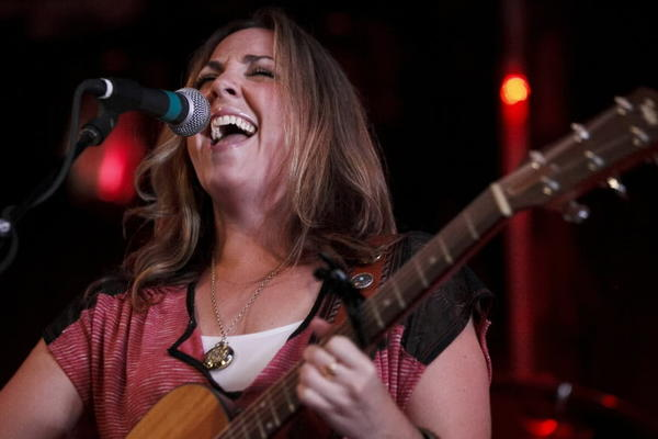 Singer-songwriter Katie Quick performs during the My Mary Cate benefit at 115 Bourbon Street in Merrionette Park, Ill. Quick's set was a mix of original music and country music covers.
