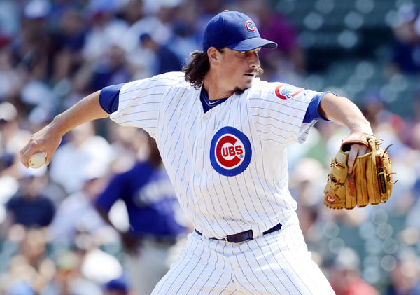 Jeff Samardzija pitches against the Rockies Friday at Wrigley Field.
