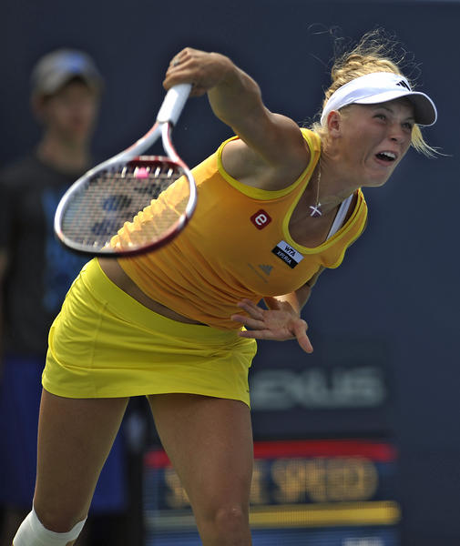 Defending champion Caroline Wozniacki of Denamrk retired after losing the first set 5-7 to Maria Kirilenko of Russia during their semifinal match Friday from the New Haven Open at Yale. Wozniacki sustained a right knee injury the day before against Dominika Cibulkova of Russia.