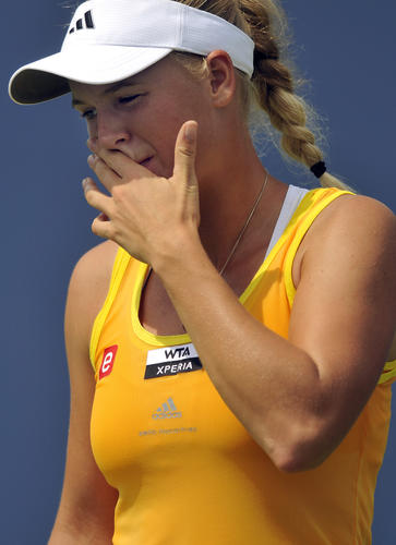 Caroline Wozniacki of Denmark retired after losing the first set 5-7 to Maria Kirilenko of Russia during their semifinal match Friday from the New Haven Open at Yale. Wozniacki, the defending champion, sustained a right knee injury against Dominika Cibulkova of Slovakia Thursday forcing her to retire Friday.