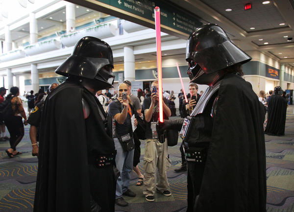 Two Darth Vaders face off during the Star Wars Celebration VI at the Orange County Convention Center on August 24, 2012.