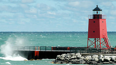 Some Charlevoix residents are asking the city council to change the paint on the Pine River Channel south pier lighthouse, pictured here on a windy day in August of 2011, back to white.