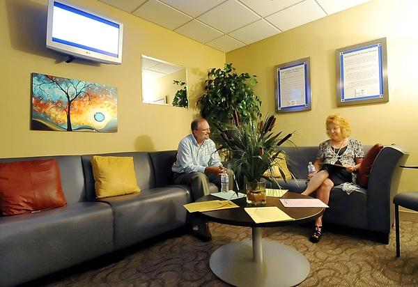 Meritus Health employees Keith Hoffman, left, and Mickey Taylor sit in the relaxation room at Meritus Health Medical Center. The room is open from 2 to 4 p.m. through Friday, Aug. 31.