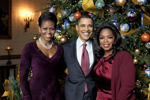 "President Barack Obama and first lady Michelle Obama, left, pose with Oprah Winfrey, right, in the Blue Room of the White House during a taping of a special, ""Christmas at the White House."""