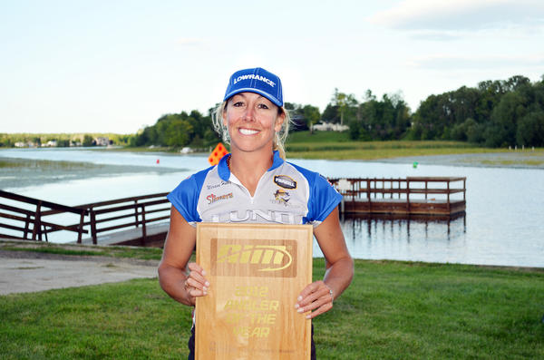 Charlevoix native Marianne Huskey displays the plaque she recieved after winning the Anglers Insight Marketing Angler of the Year award on Sunday, Aug. 19.