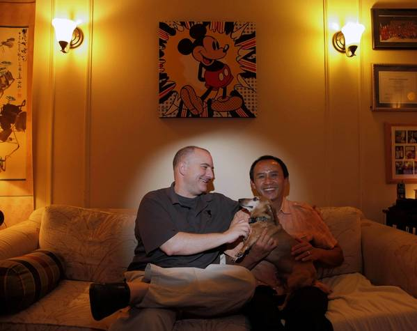 Kevin Goodman, left, Anton Pulung with their dog Tucker.