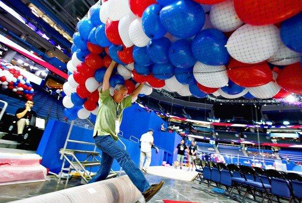 Ron Darling helps load nets with balloons for Republican National Convention festivities inside the Tampa Bay Times Forum in Tampa, Fla.