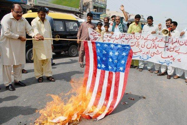 Demonstrators in Multan, Pakistan, burn a mock U.S. flag and shout slogans during a protest this week against U.S. drone attacks.