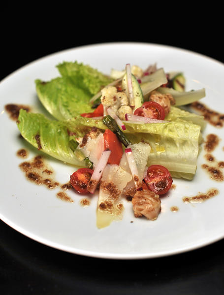 The Bagna Cauda salad at Trattoria Neapolis has romaine hearts, grilled summer vegetables, and parmigiano with garlic-anchovy dressing.