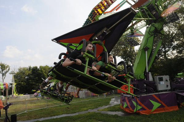 Tom Vaughn, 14, of Terryville, left, and Emmilena Russo, 14, of Plymouth take a ride on the Cliff Hanger. Friday afternoon launched the three day Terryville Country Fair in Terryville.