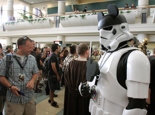 A Stormtrooper with Mickey Mouse ears poses for photographs during Star Wars Celebration VI at the Orange County Convention Center on August 24, 2012.