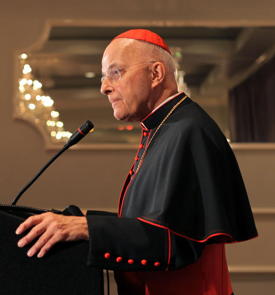 Cardinal Francis George holds a press conference to address his health concerns before attending the Hispanic Ministry Awards Banquet at the Drury Lane Conference Center in Oak Brook Terrace, Ill.