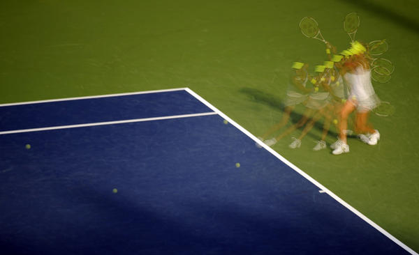 Andrea Hlavackova of the Czech Republic returns a shot during her doubles match Friday from the New Haven Open at Yale. The multiple exposure was created in camera shooting 10 consecutive frames.