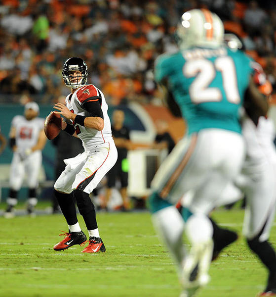 Atlanta Falcons quarterback Matt Ryan (2) throws a pass against Miami Dolphins defensive back Vontae Davis (21) during the second quarter at Sun Life Stadium.