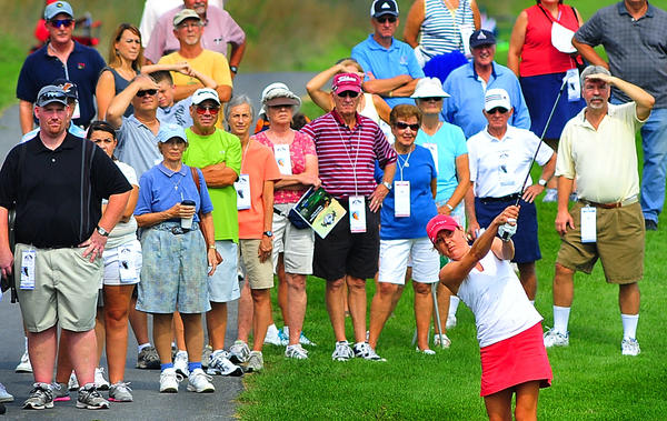 Spectators watch Hagerstown's Ashley Grier hit an approach shot toward the eighth green during the opening round of the Symetra Tours Challenge at Musket Ridge on Friday. Grier shot an even-par 72.