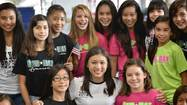 Olympic gold medal winner Kyla Ross, the youngest member of the U.S. Olympic women's gymnastics team, has her photo taken with other girls from the U.S. Gymnastics National Team Training Center.