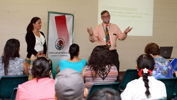 Catholic Charities Deputy Director Robert Mosher (right) answers questions during a Deferred Action for Childhood Arrivals workshop at Catholic Charities in El Centro on Friday.
