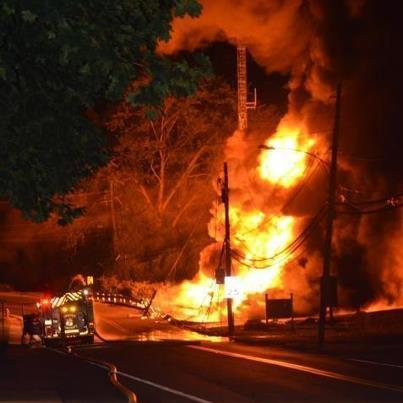 Flames shoot skyward after tanker truck carrying propane crashed and burned at the bottom of a steep hill going into Port Deposit Friday night. The driver was killed.