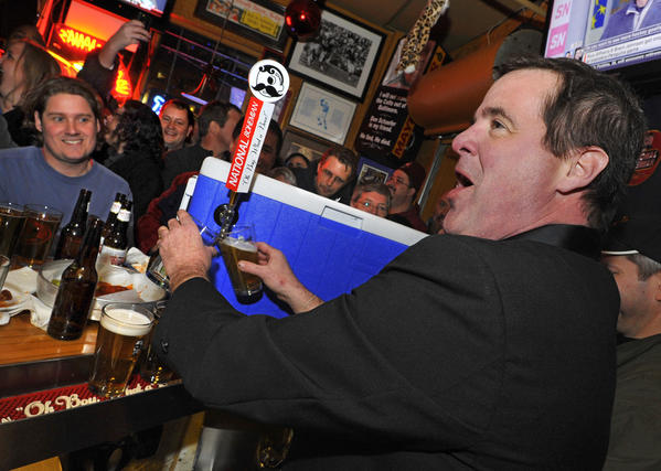 Nacho Mama's owner Scunny McCusker helps his bartenders pour the first Natty Boh's on draft from a cooler. Police said McCusker died Friday after being hit by a bus as he rode his bicycle along Coastal Highway in Ocean City.