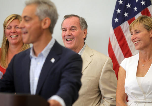 Mayor Rahm Emanuel reminisces about Chicago's former first lady Maggie Daley alongside members of the Daley family including Nora Daley Conroy, back left, former Chicago Mayor Richard M. Daley and Emanuel's wife Amy.