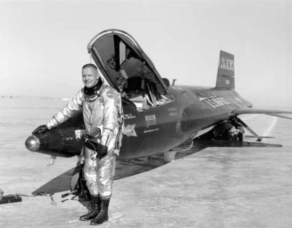 This 1960 photo from NASA shows Neil Armstrong next to an X-15, which he flew in flight-training exercises.