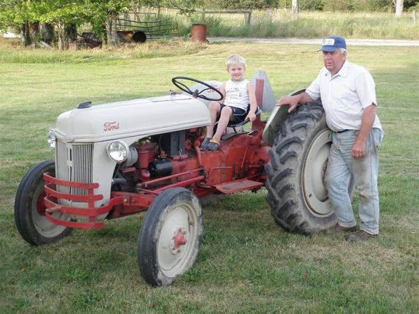 John Ferko (standing) poses beside his favorite tractor, a 1951 Ford 8N, while grandson Matthew Ferko sits behind the wheel.