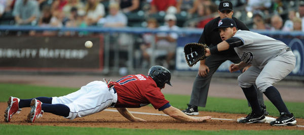 IronPig Pete Orr dives back to first base safe. The Lehigh Valley IronPigs took on the Scranton Yankees at Coca Cola Park Saturday night.