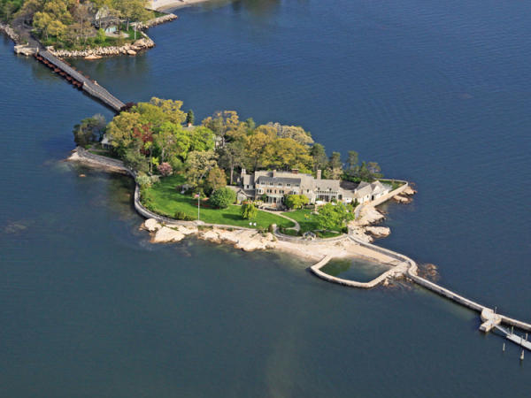 This 3.51-acre island includes an 11-bedroom 10 1/2-bathroom, 14,000-square-foot main house but in 1909, as well as a guest cottage and working greenhouse.  The island is currently on the market for $15.4 million.