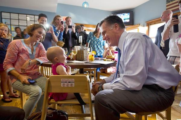 Mitt Romney visits with a future voter at a fundraising event in Nantucket, Mass.