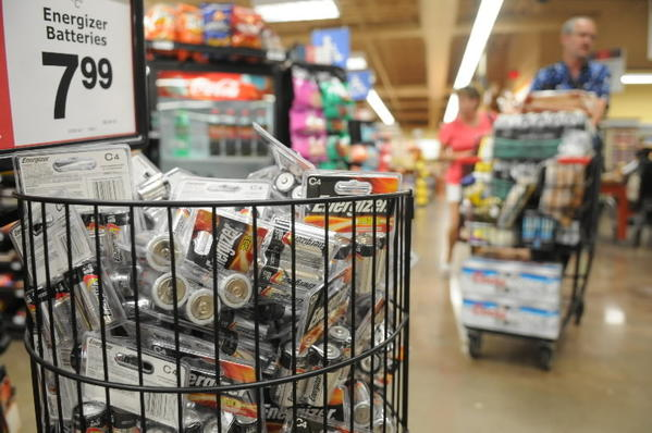 Batteries are on sale at Winn-Dixie in Davie for shoppers to stock up on hurricane supplies Friday afternoon. Publix, Winn-Dixie and other retailer stores are seeing an increase in traffic as South Florida residents begin to prepare for Tropical Storm Isaac.