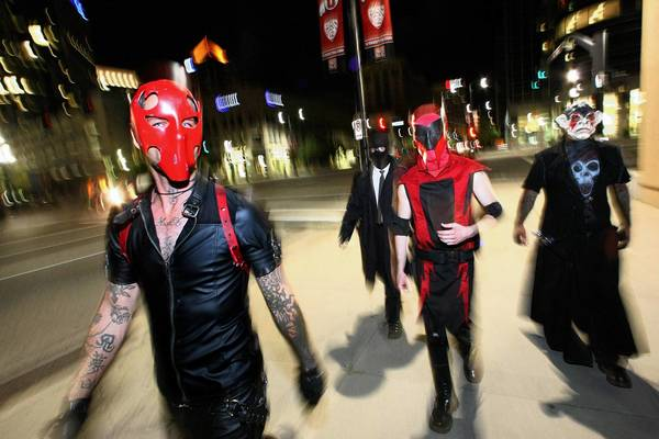 Salt Lake City's Black Monday Society walks the streets hoping to prevent crime. From left are Dave Montgomery as Nihilist, Professor Midnight (who would not give his real name), Roman Daniels as Red Voltage and Wally Gutierrez as Fool King.